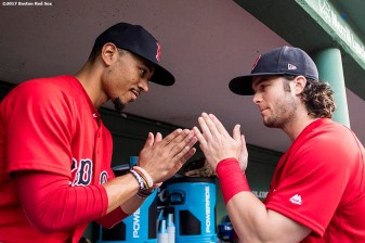 BOSTON, MA - AUGUST 4: Mookie Betts #50 high fives Andrew Benintendi #16 of the Boston Red Sox before a game against the Chicago White Sox on August 4, 2017 at Fenway Park in Boston, Massachusetts. (Photo by Billie Weiss/Boston Red Sox/Getty Images) *** Local Caption *** Andrew Benintendi; Mookie Betts