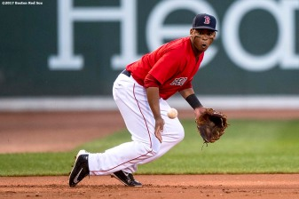 BOSTON, MA - AUGUST 4: Rafael Devers #11 of the Boston Red Sox fields a ground ball during the first inning of a game against the Chicago White Sox on August 4, 2017 at Fenway Park in Boston, Massachusetts. (Photo by Billie Weiss/Boston Red Sox/Getty Images) *** Local Caption *** Rafael Devers