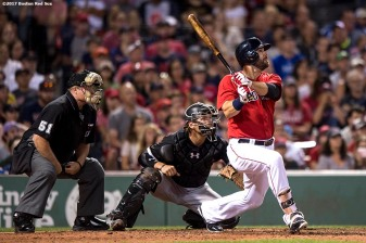 BOSTON, MA - AUGUST 4: Mitch Moreland #18 of the Boston Red Sox hits a walk-off solo home run during the eleventh inning of a game against the Chicago White Sox on August 4, 2017 at Fenway Park in Boston, Massachusetts. (Photo by Billie Weiss/Boston Red Sox/Getty Images) *** Local Caption *** Mitch Moreland