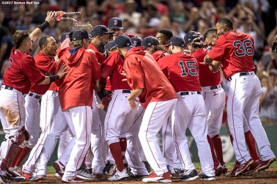 BOSTON, MA - AUGUST 4: Mitch Moreland #18 of the Boston Red Sox is mobbed by teammates after hitting a walk-off solo home run during the eleventh inning of a game against the Chicago White Sox on August 4, 2017 at Fenway Park in Boston, Massachusetts. (Photo by Billie Weiss/Boston Red Sox/Getty Images) *** Local Caption *** Mitch Moreland