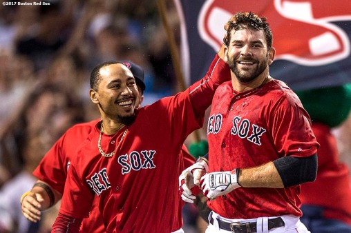 BOSTON, MA - AUGUST 4: Mitch Moreland #18 of the Boston Red Sox reacts with Mookie Betts #50 after hitting a walk-off solo home run during the eleventh inning of a game against the Chicago White Sox on August 4, 2017 at Fenway Park in Boston, Massachusetts. (Photo by Billie Weiss/Boston Red Sox/Getty Images) *** Local Caption *** Mitch Moreland; Mookie Betts