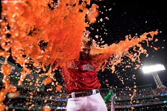 BOSTON, MA - AUGUST 4: Mitch Moreland #18 of the Boston Red Sox is doused with Powerade after hitting a walk-off solo home run during the eleventh inning of a game against the Chicago White Sox on August 4, 2017 at Fenway Park in Boston, Massachusetts. (Photo by Billie Weiss/Boston Red Sox/Getty Images) *** Local Caption *** Mitch Moreland