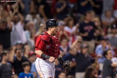 BOSTON, MA - AUGUST 4: Christian Vazquez #7 of the Boston Red Sox reacts after picking off a runner at second base during the eleventh inning of a game against the Chicago White Sox on August 4, 2017 at Fenway Park in Boston, Massachusetts. (Photo by Billie Weiss/Boston Red Sox/Getty Images) *** Local Caption *** Christian Vazquez