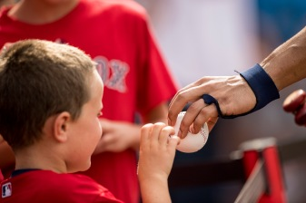 BOSTON, MA - AUGUST 5: Xander Bogaerts #2 of the Boston Red Sox hands a young fan an autographed baseball before a game against the Chicago White Sox on August 5, 2017 at Fenway Park in Boston, Massachusetts. (Photo by Billie Weiss/Boston Red Sox/Getty Images) *** Local Caption *** Xander Bogaerts