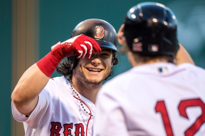 BOSTON, MA - AUGUST 5: Andrew Benintendi #16 of the Boston Red Sox reacts with Brock Holt #12 after hitting a two run home run during the first inning of a game against the Chicago White Sox on August 5, 2017 at Fenway Park in Boston, Massachusetts. (Photo by Billie Weiss/Boston Red Sox/Getty Images) *** Local Caption *** Andrew Benintendi; Brock Holt