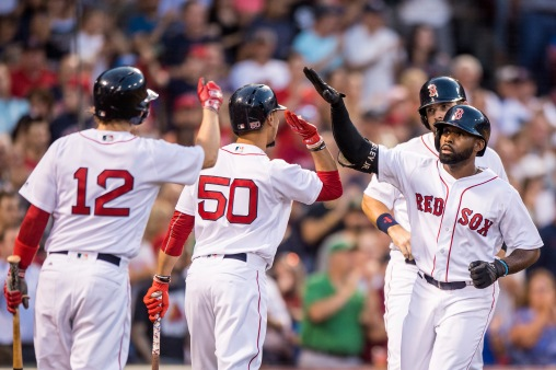 BOSTON, MA - AUGUST 5: Jackie Bradley Jr. #19 of the Boston Red Sox high fives Mitch Moreland #18, Mookie Betts #50, and Brock Holt #12 after hitting a two run home run during the second inning of a game against the Chicago White Sox on August 5, 2017 at Fenway Park in Boston, Massachusetts. (Photo by Billie Weiss/Boston Red Sox/Getty Images) *** Local Caption *** Jackie Bradley Jr.; Mitch Moreland; Mookie Betts; Brock Holt