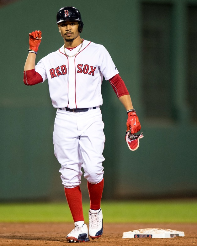 BOSTON, MA - AUGUST 5: Mookie Betts #50 of the Boston Red Sox reacts after hitting a double during the sixth inning of a game against the Chicago White Sox on August 5, 2017 at Fenway Park in Boston, Massachusetts. (Photo by Billie Weiss/Boston Red Sox/Getty Images) *** Local Caption *** Mookie Betts