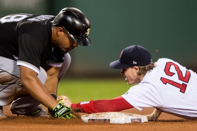 BOSTON, MA - AUGUST 5: Brock Holt #12 of the Boston Red Sox tags out Jose Abreu #79 of the Chicago White Sox during the eighth inning of a game on August 5, 2017 at Fenway Park in Boston, Massachusetts. (Photo by Billie Weiss/Boston Red Sox/Getty Images) *** Local Caption *** Brock Holt; Jose Abreu