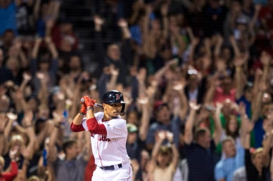 BOSTON, MA - AUGUST 5: Mookie Betts #50 of the Boston Red Sox bats as fans do the wave during the seventh inning of a game against the Chicago White Sox on August 5, 2017 at Fenway Park in Boston, Massachusetts. (Photo by Billie Weiss/Boston Red Sox/Getty Images) *** Local Caption *** Mookie Betts
