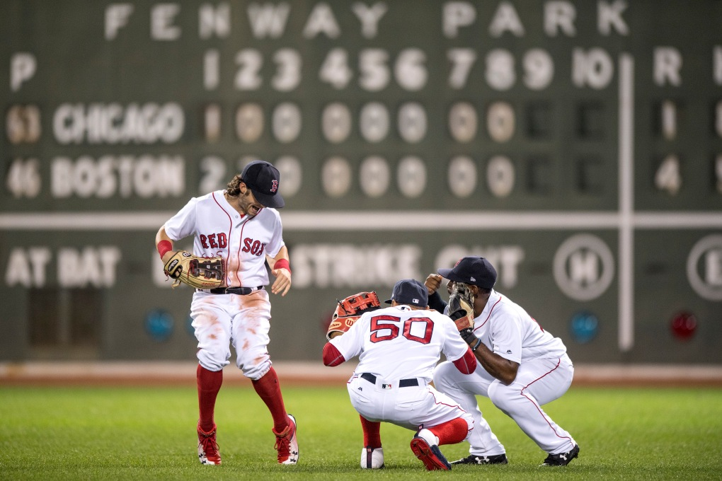 BOSTON, MA - AUGUST 5: Jackie Bradley Jr. #19, Andrew Benintendi #16, and Mookie Betts #50 of the Boston Red Sox celebrate a victory against the Chicago White Sox on August 5, 2017 at Fenway Park in Boston, Massachusetts. (Photo by Billie Weiss/Boston Red Sox/Getty Images) *** Local Caption *** Jackie Bradley Jr.; Mookie Betts; Andrew Benintendi