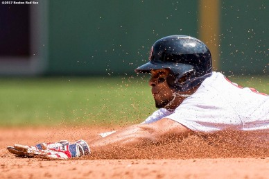 BOSTON, MA - AUGUST 6: Xander Bogaerts #2 of the Boston Red Sox dives as he steals second base during the second inning of a game against the Chicago White Sox on August 6, 2017 at Fenway Park in Boston, Massachusetts. (Photo by Billie Weiss/Boston Red Sox/Getty Images) *** Local Caption *** Xander Bogaerts