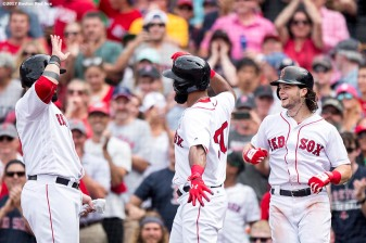 BOSTON, MA - AUGUST 6: Chris Young #30 of the Boston Red Sox high fives Andrew Benintendi #16 and Sandy Leon #3 after hitting a three run home run during the fifth inning of a game against the Chicago White Sox on August 6, 2017 at Fenway Park in Boston, Massachusetts. It was his second home run of the game. (Photo by Billie Weiss/Boston Red Sox/Getty Images) *** Local Caption *** Chris Young; Andrew Benintendi; Sandy Leon