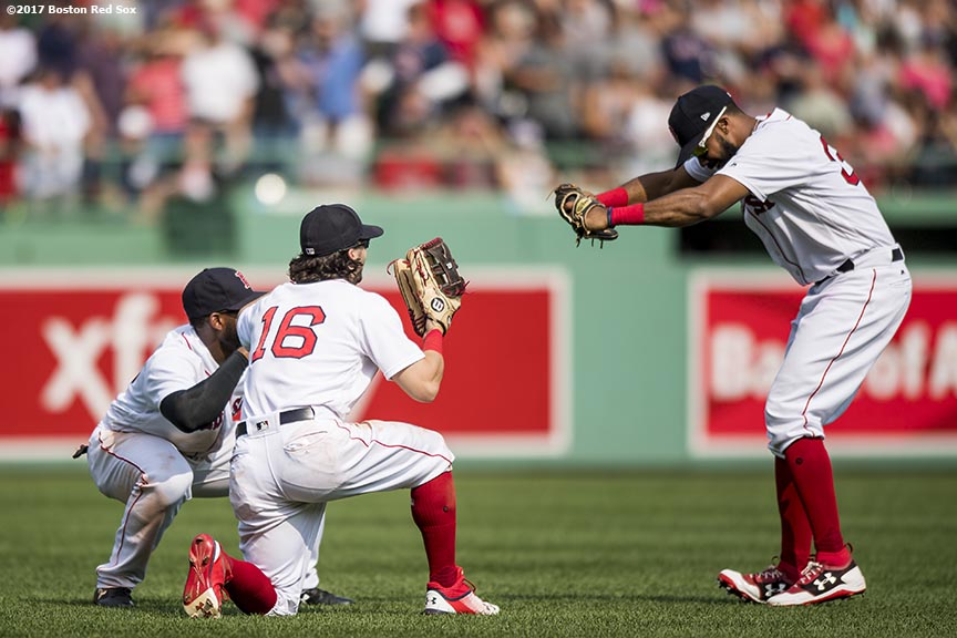 BOSTON, MA - AUGUST 6: Jackie Bradley Jr. #19, Andrew Benintendi #16, and Chris Young #30 of the Boston Red Sox celebrate a victory against the Chicago White Sox on August 6, 2017 at Fenway Park in Boston, Massachusetts. (Photo by Billie Weiss/Boston Red Sox/Getty Images) *** Local Caption *** Jackie Bradley Jr.; Andrew Benintendi; Chris Young