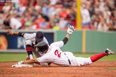BOSTON, MA - AUGUST 14: Xander Bogaerts #2 of the Boston Red Sox dives into second base and evades the tag of Francisco Lindor #12 of the Cleveland Indians after hitting a double during the third inning of a game on August 14, 2017 at Fenway Park in Boston, Massachusetts. (Photo by Billie Weiss/Boston Red Sox/Getty Images) *** Local Caption *** Xander Bogaerts; Francisco Lindor
