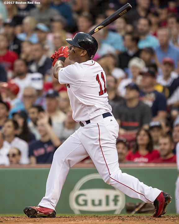 BOSTON, MA - AUGUST 14: Rafael Devers #11 of the Boston Red Sox hits a solo home run during the fourth inning of a game against the Cleveland Indians on August 14, 2017 at Fenway Park in Boston, Massachusetts. It was his second home run of the game. (Photo by Billie Weiss/Boston Red Sox/Getty Images) *** Local Caption *** Rafael Devers