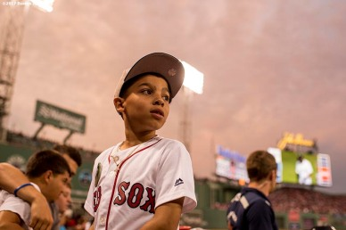 BOSTON, MA - AUGUST 14: A young fan looks on during a game between the Boston Red Sox and the Cleveland Indians on August 14, 2017 at Fenway Park in Boston, Massachusetts. (Photo by Billie Weiss/Boston Red Sox/Getty Images) *** Local Caption ***