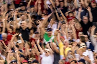 BOSTON, MA - AUGUST 14: Fans participate in the wave during a game between the Boston Red Sox and the Cleveland Indians on August 14, 2017 at Fenway Park in Boston, Massachusetts. (Photo by Billie Weiss/Boston Red Sox/Getty Images) *** Local Caption ***