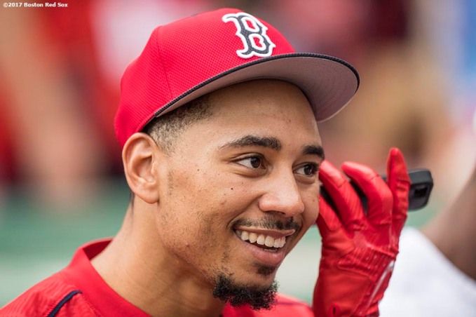 BOSTON, MA - AUGUST 15: Mookie Betts #50 of the Boston Red Sox talks on the phone before a game against the St. Louis Cardinals on August 15, 2017 at Fenway Park in Boston, Massachusetts. (Photo by Billie Weiss/Boston Red Sox/Getty Images) *** Local Caption *** Mookie Betts