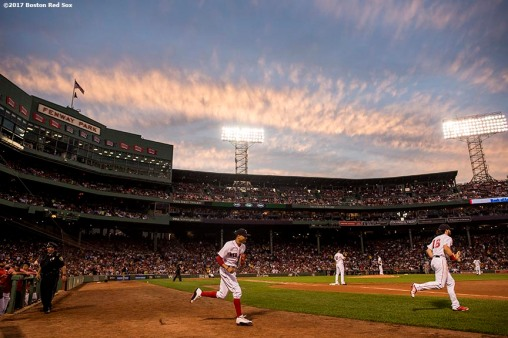 BOSTON, MA - AUGUST 15: Mookie Betts #50 and Andrew Benintendi #16 of the Boston Red Sox run onto the field as the sun sets during the second inning of a game against the St. Louis Cardinals on August 15, 2017 at Fenway Park in Boston, Massachusetts. (Photo by Billie Weiss/Boston Red Sox/Getty Images) *** Local Caption *** Mookie Betts; Andrew Benintendi