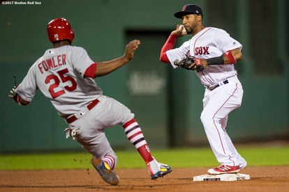 BOSTON, MA - AUGUST 15: Eduardo Nunez #36 of the Boston Red Sox throws to first base to record the second out of a triple play as Dexter Fowler #25 of the St. Louis Cardinals slides during the fourth inning of a game on August 15, 2017 at Fenway Park in Boston, Massachusetts. (Photo by Billie Weiss/Boston Red Sox/Getty Images) *** Local Caption *** Eduardo Nunez; Dexter Fowler