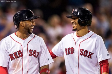 BOSTON, MA - AUGUST 15: Eduardo Nunez #36 and Mookie Betts #50 of the Boston Red Sox react after scoring during the fourth inning of a game against the St. Louis Cardinals on August 15, 2017 at Fenway Park in Boston, Massachusetts. (Photo by Billie Weiss/Boston Red Sox/Getty Images) *** Local Caption *** Eduardo Nunez; Mookie Betts