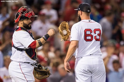 BOSTON, MA - AUGUST 15: Robby Scott #63 of the Boston Red Sox high fives Sandy Leon #3 after defeating the St. Louis Cardinals on August 15, 2017 at Fenway Park in Boston, Massachusetts. (Photo by Billie Weiss/Boston Red Sox/Getty Images) *** Local Caption *** Robby Scott; Sandy Leon
