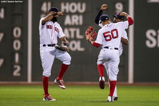 BOSTON, MA - AUGUST 15: Chris Young #30, Jackie Bradley Jr. #19, and Mookie Betts #50 of the Boston Red Sox celebrate a victory against the St. Louis Cardinals on August 15, 2017 at Fenway Park in Boston, Massachusetts. (Photo by Billie Weiss/Boston Red Sox/Getty Images) *** Local Caption *** Chris Young; Jackie Bradley Jr.; Mookie Betts