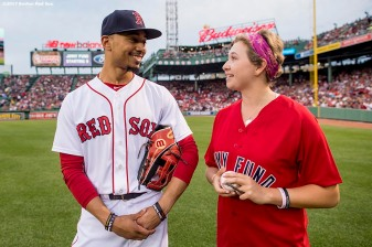 BOSTON, MA - AUGUST 15: Mookie Betts #50 of the Boston Red Sox greets a Jimmy Fund patient during a Jimmy Fund Radio-Telethon pre-game ceremony before a game between the Boston Red Sox and the St. Louis Cardinals on August 15, 2017 at Fenway Park in Boston, Massachusetts. (Photo by Billie Weiss/Boston Red Sox/Getty Images) *** Local Caption *** Mookie Betts