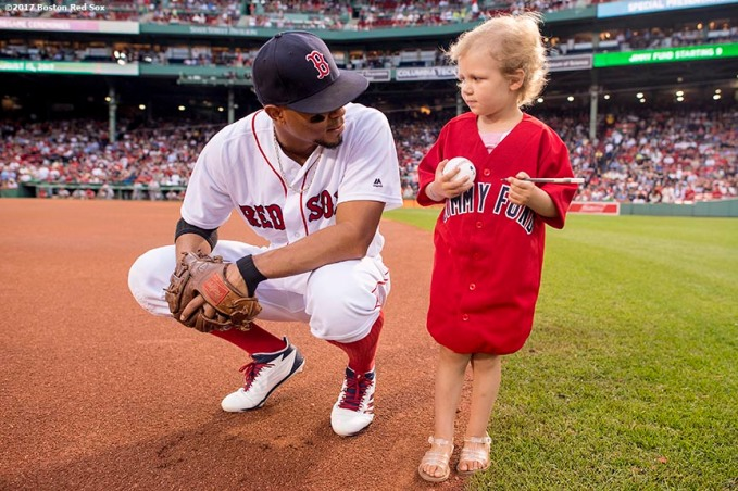 BOSTON, MA - AUGUST 15: Xander Bogaerts #2 of the Boston Red Sox greets a Jimmy Fund patient during a Jimmy Fund Radio-Telethon pre-game ceremony before a game between the Boston Red Sox and the St. Louis Cardinals on August 15, 2017 at Fenway Park in Boston, Massachusetts. (Photo by Billie Weiss/Boston Red Sox/Getty Images) *** Local Caption *** Xander Bogaerts