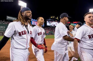 BOSTON, MA - AUGUST 16: Mookie Betts #50 of the Boston Red Sox is congratulated by teammates after hitting the game winning walk-off double during the ninth inning of a game against the St. Louis Cardinals on August 16, 2017 at Fenway Park in Boston, Massachusetts. (Photo by Billie Weiss/Boston Red Sox/Getty Images) *** Local Caption *** Mookie Betts