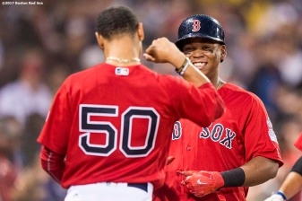 BOSTON, MA - AUGUST 18: Rafael Devers #11 of the Boston Red Sox reacts with Mookie Betts #50 after hitting a two run home run during the second inning of a game against the New York Yankees on August 18, 2017 at Fenway Park in Boston, Massachusetts. (Photo by Billie Weiss/Boston Red Sox/Getty Images) *** Local Caption *** Rafael Devers; Mookie Betts