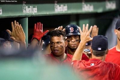 BOSTON, MA - AUGUST 18: Rafael Devers #11 of the Boston Red Sox high fives teammates after hitting a two run home run during the second inning of a game against the New York Yankees on August 18, 2017 at Fenway Park in Boston, Massachusetts. (Photo by Billie Weiss/Boston Red Sox/Getty Images) *** Local Caption *** Rafael Devers