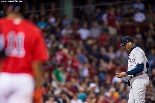 BOSTON, MA - AUGUST 18: Aroldis Chapman #54 of the New York Yankees reacts after allowing a hit to Rafael Devers #11 of the Boston Red Sox during the eighth inning of a game on August 18, 2017 at Fenway Park in Boston, Massachusetts. (Photo by Billie Weiss/Boston Red Sox/Getty Images) *** Local Caption *** Aroldis Chapman; Rafael Devers