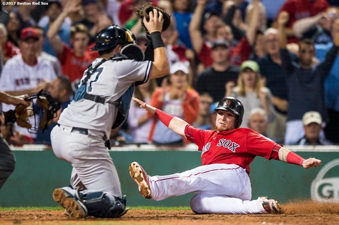 BOSTON, MA - AUGUST 18: Christian Vazquez #7 of the Boston Red Sox evades the tag of Gary Sanchez #24 of the New York Yankees as he scores during the eighth inning of a game on August 18, 2017 at Fenway Park in Boston, Massachusetts. (Photo by Billie Weiss/Boston Red Sox/Getty Images) *** Local Caption *** Christian Vazquez; Gary Sanchez