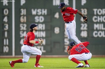 BOSTON, MA - AUGUST 18: Andrew Benintendi #16, Jackie Bradley Jr. #19, and Mookie Betts #50 of the Boston Red Sox celebrate a victory against the New York Yankees on August 18, 2017 at Fenway Park in Boston, Massachusetts. (Photo by Billie Weiss/Boston Red Sox/Getty Images) *** Local Caption *** Andrew Benintendi; Jackie Bradley Jr.; Mookie Betts
