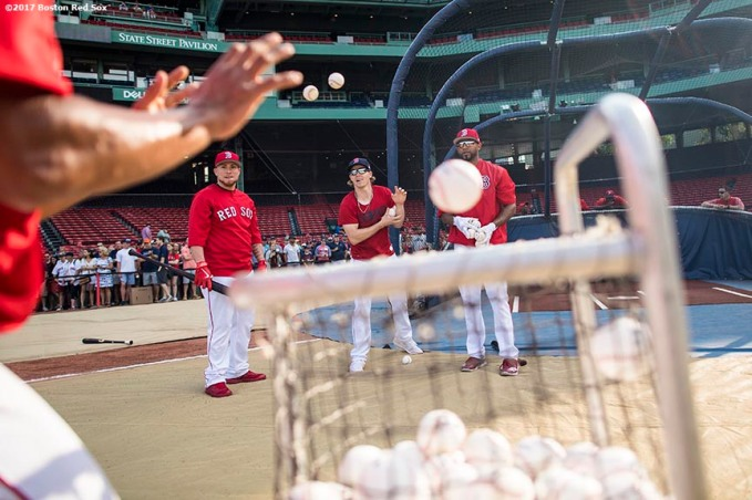 BOSTON, MA - AUGUST 19: Members of the Boston Red Sox toss baseballs into a basket before a game against the New York Yankees on August 19, 2017 at Fenway Park in Boston, Massachusetts. (Photo by Billie Weiss/Boston Red Sox/Getty Images) *** Local Caption ***