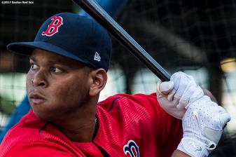 BOSTON, MA - AUGUST 19: Rafael Devers #11 of the Boston Red Sox takes batting practice before a game against the New York Yankees on August 19, 2017 at Fenway Park in Boston, Massachusetts. (Photo by Billie Weiss/Boston Red Sox/Getty Images) *** Local Caption *** Rafael Devers