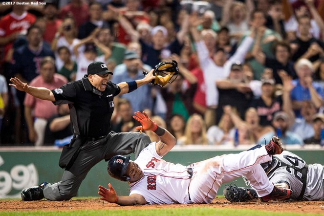 BOSTON, MA - AUGUST 19: Umpire Tripp Gibson #73 gestures safe as Rafael Devers #11 of the Boston Red Sox evades the tag of Gary Sanchez #24 of the New York Yankees as he scores during the fifth inning of a game on August 19, 2017 at Fenway Park in Boston, Massachusetts. (Photo by Billie Weiss/Boston Red Sox/Getty Images) *** Local Caption *** Rafael Devers; Gary Sanchez; Tripp Gibson