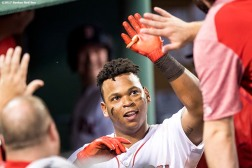 BOSTON, MA - AUGUST 19: Rafael Devers #11 of the Boston Red Sox high fives teammates after hitting a solo home run during the seventh inning of a game against the New York Yankees on August 19, 2017 at Fenway Park in Boston, Massachusetts. (Photo by Billie Weiss/Boston Red Sox/Getty Images) *** Local Caption *** Rafael Devers