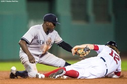 BOSTON, MA - AUGUST 19: Brock Holt #12 of the Boston Red Sox is tagged out by Didi Gregorius #18 of the New York Yankees while attempting to steal during the ninth inning of a game on August 19, 2017 at Fenway Park in Boston, Massachusetts. (Photo by Billie Weiss/Boston Red Sox/Getty Images) *** Local Caption *** Brock Holt; Didi Gregorius