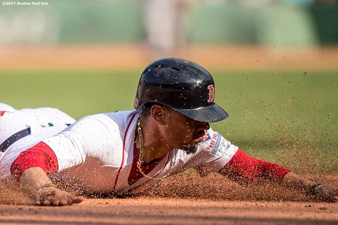 BOSTON, MA - AUGUST 20: Mookie Betts #50 of the Boston Red Sox slides into third base during the seventh inning of a game against the New York Yankees on August 20, 2017 at Fenway Park in Boston, Massachusetts. (Photo by Billie Weiss/Boston Red Sox/Getty Images) *** Local Caption *** Mookie Betts