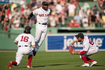 BOSTON, MA - AUGUST 20: Andrew Benintendi #16, Mookie Betts #50, and Jackie Bradley Jr. #19 of the Boston Red Sox celebrate a victory against the New York Yankees on August 20, 2017 at Fenway Park in Boston, Massachusetts. (Photo by Billie Weiss/Boston Red Sox/Getty Images) *** Local Caption *** Andrew Benintendi; Mookie Betts; Jackie Bradley Jr.