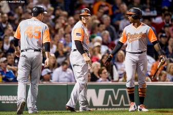 BOSTON, MA - AUGUST 25: Mark Trumbo #45 and Chris Davis #19 high five Tim Beckham #1 of the Baltimore Orioles after scoring during the fifth inning of a game against the Boston Red Sox on August 25, 2017 at Fenway Park in Boston, Massachusetts. (Photo by Billie Weiss/Boston Red Sox/Getty Images) *** Local Caption *** Mark Trumbo; Chris Davis; Tim Beckham