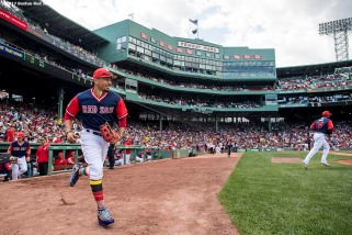 BOSTON, MA - AUGUST 27: Mookie Betts #50 of the Boston Red Sox runs onto the field before a game against the Baltimore Orioles on August 27, 2017 at Fenway Park in Boston, Massachusetts. (Photo by Billie Weiss/Boston Red Sox/Getty Images) *** Local Caption *** Mookie Betts