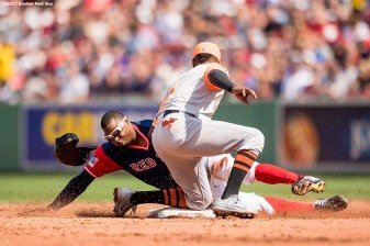 BOSTON, MA - AUGUST 27: Rajai Davis #25 of the Boston Red Sox is tagged out by Tim Beckham #1 of the Baltimore Orioles as he attempts to steal second base during the fourth inning of a games on August 27, 2017 at Fenway Park in Boston, Massachusetts. (Photo by Billie Weiss/Boston Red Sox/Getty Images) *** Local Caption *** Rajai Davis; Tim Beckham