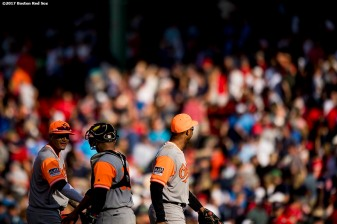 BOSTON, MA - AUGUST 27: Manny Machado #13 of the Baltimore Orioles high fives teammates after a victory against the Boston Red Sox on August 27, 2017 at Fenway Park in Boston, Massachusetts. (Photo by Billie Weiss/Boston Red Sox/Getty Images) *** Local Caption *** Manny Machado