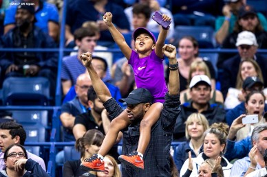 August 29, 2017, New York City, NY: A young fan cheers during a match between Roger Federer and Frances Tiafoe during the 2017 US Open Tennis Championships at the Billie Jean King National Tennis Center in New York, New York Tuesday, August 29, 2017. (Photo by Billie Weiss/US Open Tennis Championships)