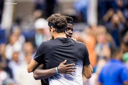 August 29, 2017, New York City, NY: Frances Tiafoe and Roger Federer embrace after a five set match in which Federer defeated Tiafoe during the 2017 US Open Tennis Championships at the Billie Jean King National Tennis Center in New York, New York Tuesday, August 29, 2017. (Photo by Billie Weiss/US Open Tennis Championships)