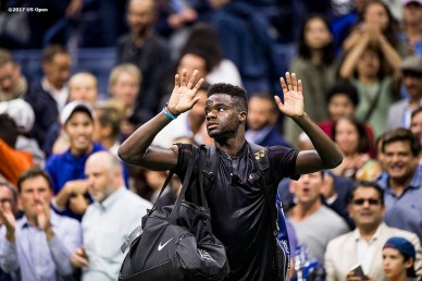 August 29, 2017, New York City, NY: Frances Tiafoe waves to the crowd after losing a match against Roger Federer during the 2017 US Open Tennis Championships at the Billie Jean King National Tennis Center in New York, New York Tuesday, August 29, 2017. (Photo by Billie Weiss/US Open Tennis Championships)
