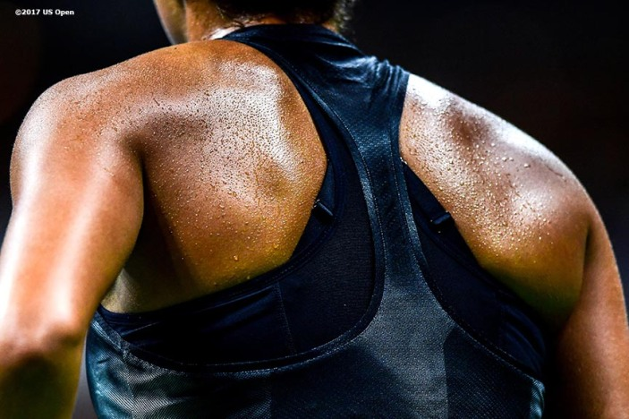 August 29, 2017, New York City, NY: Sweat drips off the back of Madison Keys during a match against Elise Mertens during the 2017 US Open Tennis Championships at the Billie Jean King National Tennis Center in New York, New York Tuesday, August 29, 2017. (Photo by Billie Weiss/US Open Tennis Championships)